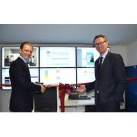 Christian Rychly, Managing Director of Leonhardt & Blumberg (left) and Knut Ørbeck-Nilssen, CEO of DNV GL – Maritime (right) cut the ribbon. (Photo: DNV GL)