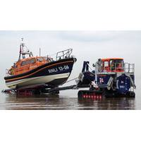 The RNLI has also introduced a new launch and recovery tractor, designed in conjunction with high-mobility-vehicles specialist Supacat Ltd, specifically for use with the Shannon. It acts as a mobile slipway.  Pictured is the Hoylake, UK Shannon class lifeboat being recovered from the sea. (Photo: RNLI/Dave James)