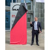 Uwe Lauber, CEO MAN Energy Solutions unveiling the new company name in the Augsburg Headquarter (Photo: MAN Energy Solutions)