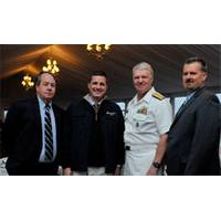"""From Left: John O'Malley, owner and publisher, Marine Technology Reporter; Rob Howard, VP Sales & Marketing; U.S. Navy CNO Admiral Gary Roughead; and Greg Trauthwein, Associate Publisher and Editor. The CNO was conferred """"Seamaster 2011"""" at the OceanTech Expo in Newport, RI. (Photo: U.S. Navy)"""