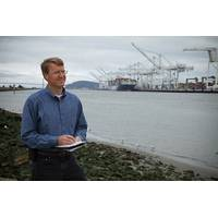 Sandia National Laboratories researcher Joe Pratt stands near the Port of Oakland, one of the west coast ports he studied to learn whether hydrogen fuel cells are a viable power source for docked ships. (Photo by Steffan Schulz)