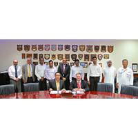 Terry McGowan, President and CEO, Thordon Bearings (seated right), and Mohammad Rizal (left), Chief Operating Officer of Drydocks World- Dubai, sign an agreement that affirms the two companies' efforts to convert ships to seawater lubricated propeller shaft lines from oil (Photo: Thordon Bearings)