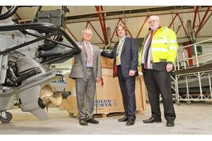 Bob Troop, chair and managing director James Troop & Co (in hi-vis jacket); Anthony Ward, engine sales executive James Troop & Co (grey suit); and Philip Hilbert, sales director MST (blue suit); seen with one of the new vessels at MST's construction facility and HQ, at Atlantic Way, Liverpool. (Photo: James Troop)