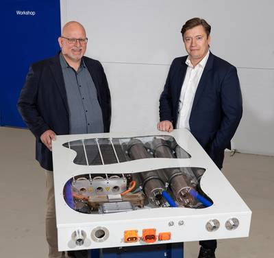 Mads Friis Jensen, CCO and Co-founder, Blue World Technologies together with Lars Bo Andersen,  Manager of Alfa Laval Test and Training Centre - HTPEM fuel cell at Alfa Laval Test & Training. Photo courtesy Alfa Laval