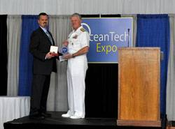U.S. Navy CNO Admiral Gary Roughead (right) receiving the Seamaster 2011 award from Greg Trauthwein, Associate Publisher and Editor, Marine Technology Reporter, at the OceanTech Expo 2011 in Newport, RI. (Photo: U.S. Navy)
