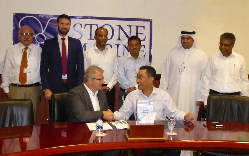DDW Chief Operations Officer, Mohammad Rizal, shaking hands with Don Quilliam, Managing Director of Stone Marine Shipcare Ltd., with senior executives from both company's looking on. (Photo: Stone Marine Shipcare)
