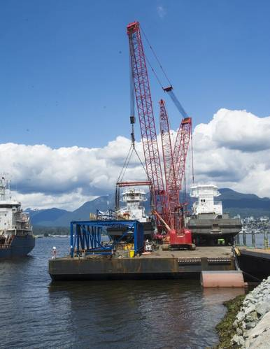 Two tugs and two cranes on the barge as it arrived in Vancouver's Burrard Inlet. (Photo: Haig-Brown / Cummins)