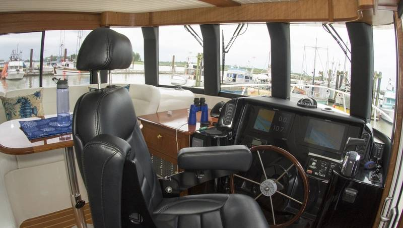 The elevated wheelhouse gives a commanding view with a room lounge. Photo: Haig-Brown/Cummins