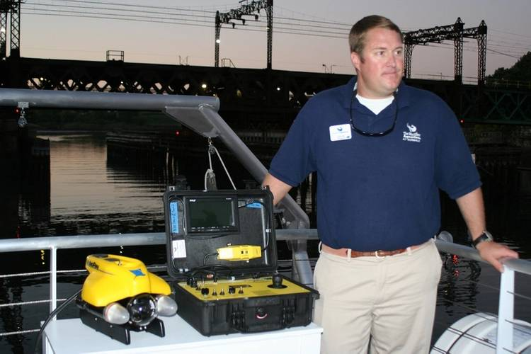 New research vessel for The Maritime Aquarium at Norwalk comes with an underwater ROV (Remotely Operated Vehicle) equipped with cameras that will allow students to explore the bottom of Long Island Sound, shipwrecks in the Sound and more. Shown with Aquarium Educator Colin Thom. (Photo courtesy of the Maritime Aquarium at Norwalk)