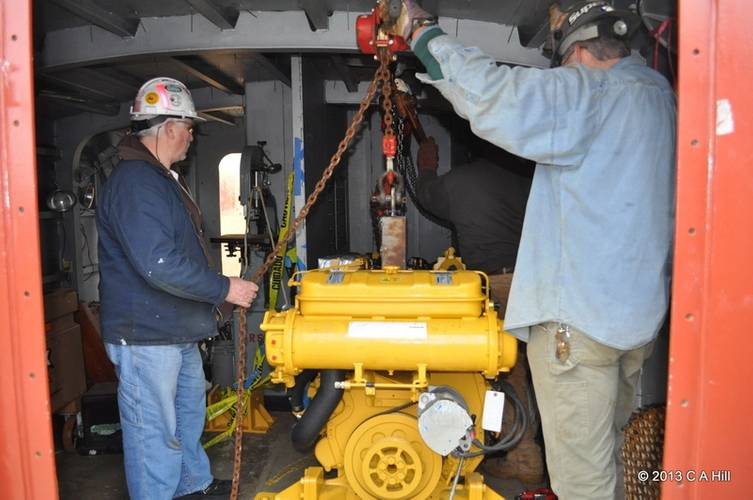 At Senesco Marine, workers load the Caterpillar C-12 main engines from Milton Cat onto the SSV Oliver Hazard Perry. (Photo Credit: OHPRI/Carol Hill)