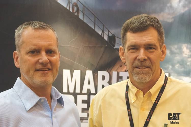 "T.E. ""Dra"" Wiersema (right), Product Manager, Caterpillar Marine, spoke to Greg Trauthwein (left) for Maritime Reporter TV in New Orleans regarding Caterpillar new Multi-Engine Optimizer (MEO). (Photo: Eric Haun)"